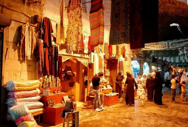 Al-Madina souk before burning: history alive in the present
